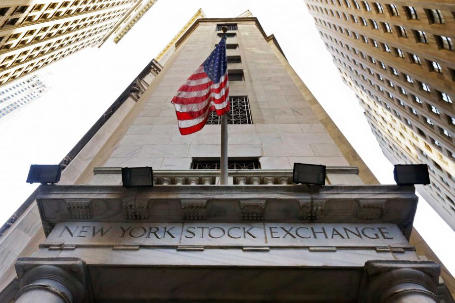 In this Friday, Nov. 13, 2015, photo, the American flag flies above the Wall Street entrance to the New York Stock Exchange, in New York. U.S. stocks are wavering between small gains and losses Thursday, Jan. 28, 2016, following a sharp sell-off the day before. Photo: Richard Drew, AP / AP