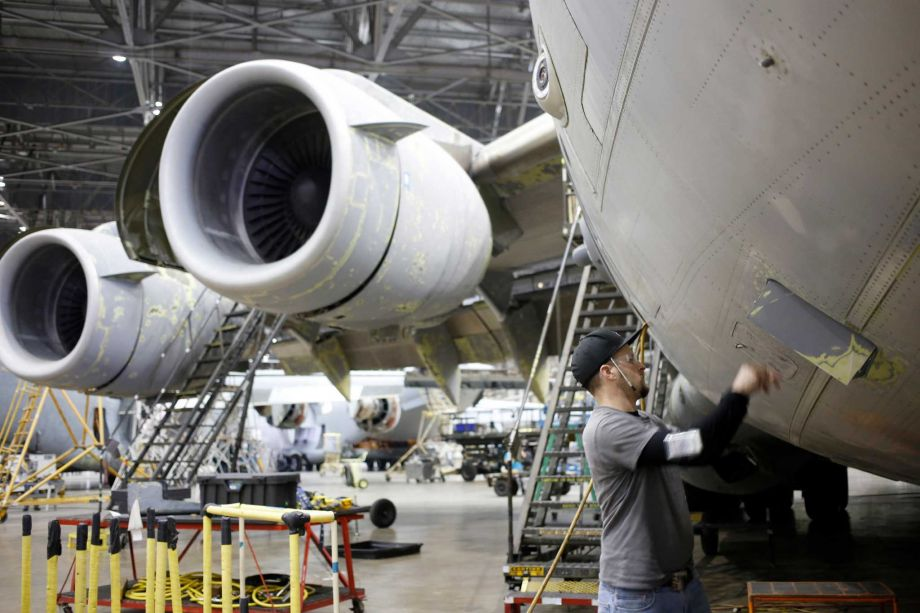 A maintenance technician inspects a U.S Air Force Boeing C-17 Globemaster III airplane at the Boeing Co. Global Services and Support facility in San Antonio, Texas, on Thursday. Government figures Friday are forecast to show GDP growth decelerated in the final three months of 2015, with a sharp slackening in inventories by manufacturers and other businesses and a larger trade deficit behind the slowdown. Must credit: Bloomberg photo by Luke Sharrett. Photo: Luke Sharrett / © 2016 Bloomberg Finance LP