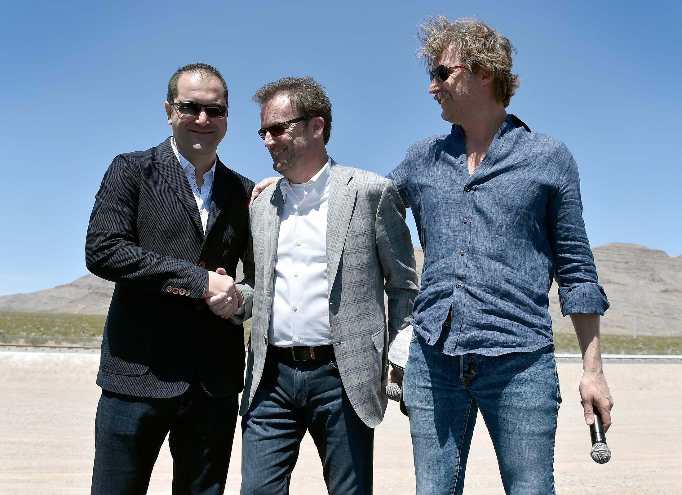 NORTH LAS VEGAS, NV - MAY 11:  (L-R) Hyperloop One Co-Founder & Executive Chairman Shervin Pishevar, Hyperloop One Chief Executive Officer Rob Lloyd and Co-Founder & Chief Technology Officer Brogan BamBrogan speak during the first test of the propulsion system at the Hyperloop One Test and Safety site on May 11, 2016 in North Las Vegas, Nevada. The company plans to create a fully operational hyperloop system by 2020.  (Photo by David Becker/Getty Images,)