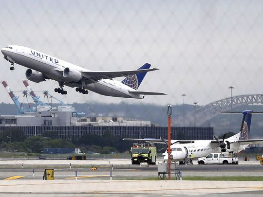 A United Airlines plane takes off July 25, 2013, from