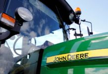 The Justice Department filed a lawsuit in an Illinois federal court, asking a judge to block Deere's planned deal with Monsanto.