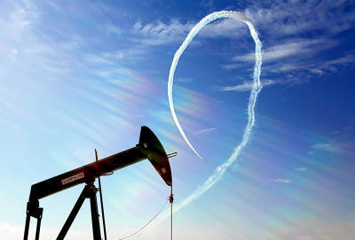 An oil pump stands as the Saudi Hawks Aerobatic Team of the Royal Saudi Air Force performs during the Bahrain International Airshow in Sakhir, Bahrain, on Jan. 23. (AP Photo/Hasan Jamali, File)