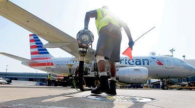 Scott Mills finishes fueling up an American Airlines jet at Dallas/Fort Worth International Airport in Grapevine, Texas, in August 2015. (AP Photo/LM Otero, File)