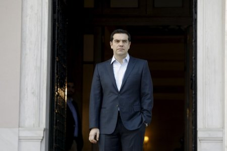 Greek Prime Minister Alexis Tsipras arrives to welcome General Secretary of OECD Angel Gurria (not pictured) at the Maximos Mansion in Athens, Greece, March 10, 2016. REUTERS/Michalis Karagiannis